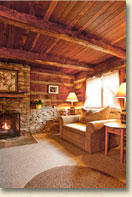 rustic mountain cabin with fireplace at cataloochee ranch and resort
