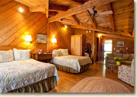 room with two queen beds in rustic lodge in smoky mountain resort